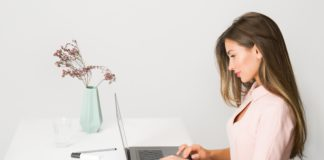 woman in pink dress using laptop computer 1586973 1 scaled